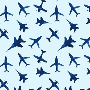 Watercolor airplanes on blue