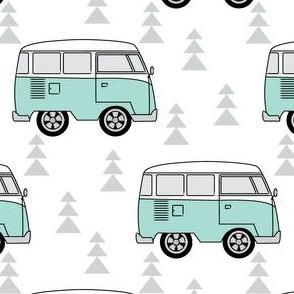 vintage teal camper vans and trees