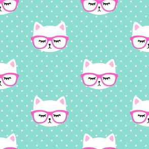 cat with hot pink glasses on polka dots