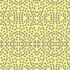 A Lacy Mesh of Twinkling Dots on Buttery Yellow