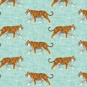 walking tiger on dark mint (woven)