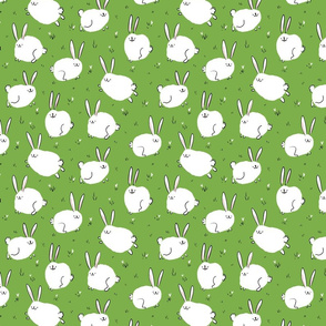 Fluffy cheerful bunnies on a green field Small Scale