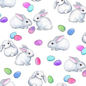 Easter Bunnies with Rainbow Pastel Eggs on white