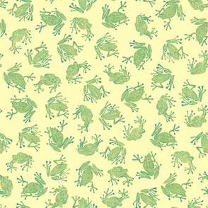 small green frogs on pale yellow