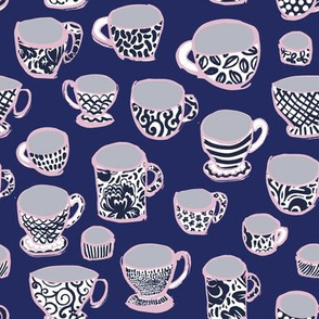 Blue and White China Tea Cups on Dark Blue with pink