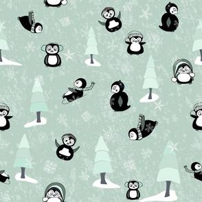 Playful Penguins on Mint Green