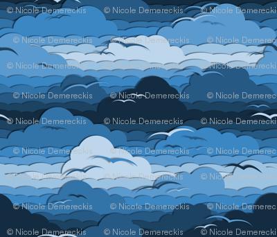 Birds in Cloudy Blue Sky