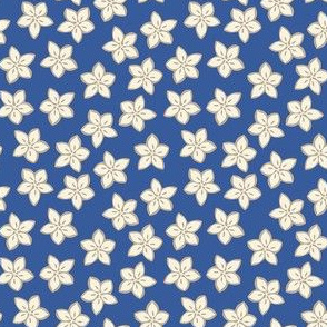 small flowers in cream on blue background