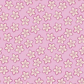 Small cream and dark pink flowers on a pink background