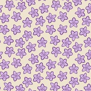 small purple flowers on cream