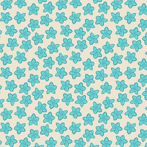 Small turquoise flowers on cream