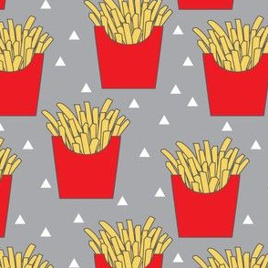 french fries with red box on dark grey
