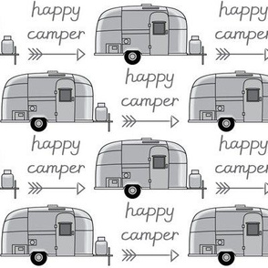 vintage silver trailer with happy camperarrow