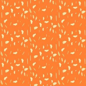 gold paint daubs on orange