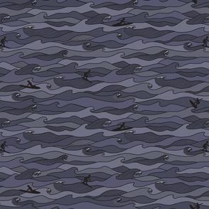 surfing waves in midnight blue