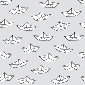 paper boats on grey