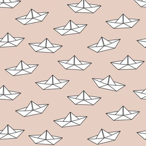 paper boats on brown