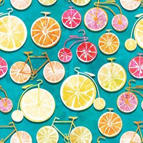 Juicy ride //  blue background multicoloured lemons oranges and bikes