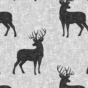 dark grey bucks on light grey linen