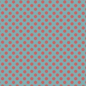 Rust polka dots on teal background