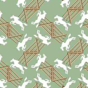 White Jumping Horses on Green