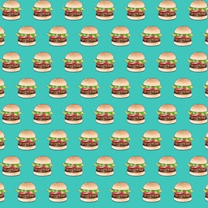 Rows of burgers on sea green