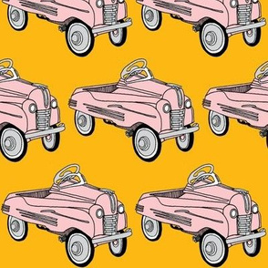 Pink 1930's Child's Pedal Car on golden background