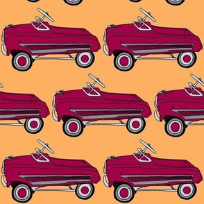 Red Fifties Style Chikd's Pedal Car on orange