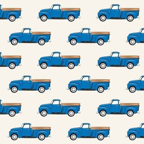 vintage blue truck on cream