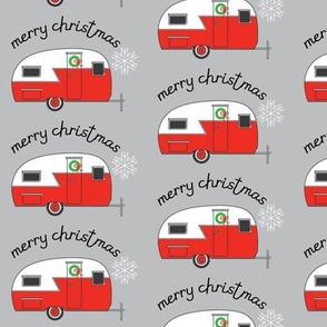 merry christmas retro trailer on grey
