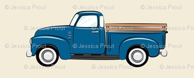 vintage blue truck on dark cream