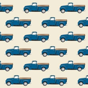 vintage blue truck on dark cream
