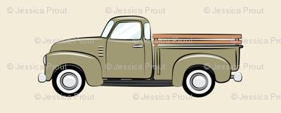 vintage green truck on dark cream