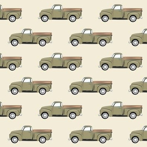 vintage green truck on dark cream