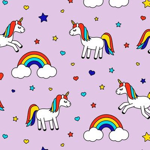 unicorns with rainbows (primary) on light purple