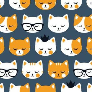 cat faces - orange on blue