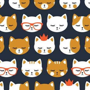 cat faces on dark blue