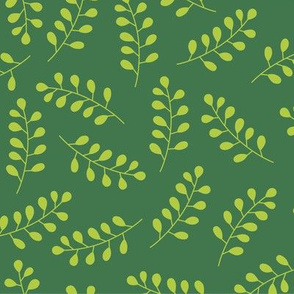 Green laurel branches on dark green