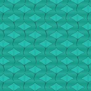 spotted eagle rays in green