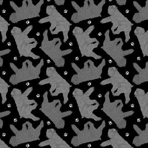 Trotting Bouvier des Flandres and paw prints C - black