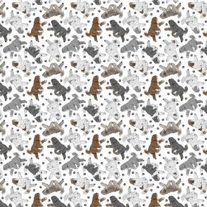 Trotting Polish Lowland Sheepdogs and paw prints B - tiny white