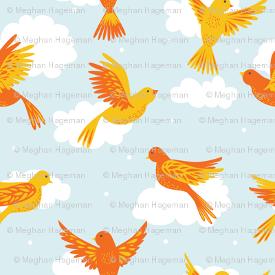 Yellow and Orange Birds in Flight on a Blue Sky