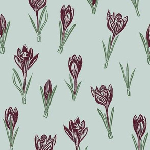 dark red crocuses on light greyed teal