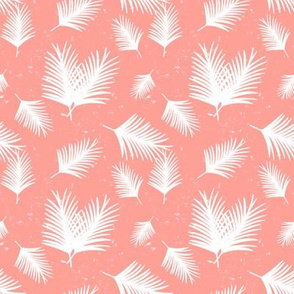Smaller Distressed White Tropical Palm Leaves Scattered on Coral