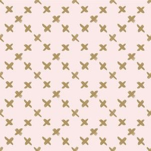 Gold x on baby pink