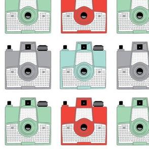 vintage brownie cameras on white