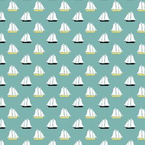 Sailboats on aqua blue