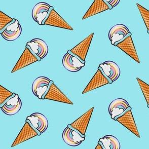 pastel rainbow icecream cones on blue (toss)