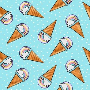 pastel rainbow icecream cones on blue with dots (toss)