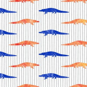 alligators - bright blue and orange on stripes